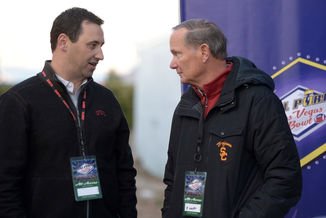 Dec 21, 2013; Las Vegas, NV, USA; Southern California Trojans coach Steve Sarkisian (left) and athletic director Pat Haden at the Las Vegas Bowl against the Fresno State Bulldogs at Sam Boyd Stadium. USC defeated Fresno State 45-20. Mandatory Credit: Kirby Lee-USA TODAY Sports
