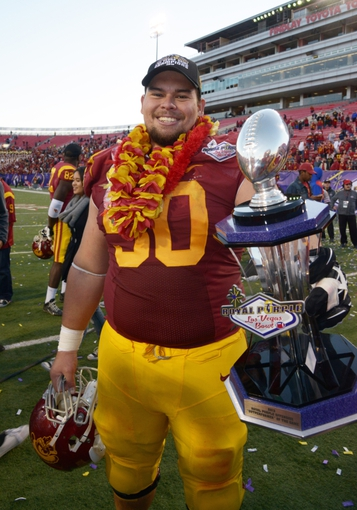 Dec 21, 2013; Las Vegas, NV, USA; Southern California Trojans center Abe Markowitz (50) holds the Las Vegas Bowl champion trophy after the game against the Fresno State Bulldogs at Sam Boyd Stadium. USC defeated Fresno State 45-20. Mandatory Credit: Kirby Lee-USA TODAY Sports