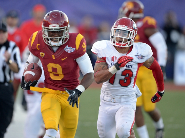 Dec 21, 2013; Las Vegas, NV, USA; Southern California Trojans receiver Marqise Lee (9) is pursued by Fresno State Bulldogs safety Derron Smith (13) on a 40-yard reception in the fourth quarter in the Las Vegas Bowl at Sam Boyd Stadium. USC defeated Fresno State 45-20. Mandatory Credit: Kirby Lee-USA TODAY Sports