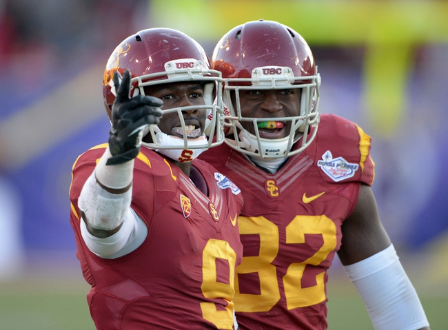 Dec 21, 2013; Las Vegas, NV, USA; Southern California Trojans center Marqise Lee (9) celebrates with tight end Randall Telfer (82) after a 40-yard reception against Fresno State Bulldogs in the fourth quarter of the Las Vegas Bowl at Sam Boyd Stadium. USC defeated Fresno State 45-20. Mandatory Credit: Kirby Lee-USA TODAY Sports