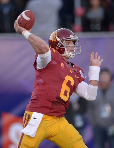 Dec 21, 2013; Las Vegas, NV, USA; Southern California Trojans quarterback Cody Kessler (6) throws a pass against the Fresno State Bulldogs in the Las Vegas Bowl at Sam Boyd Stadium. USC defeated Fresno State 45-20. Mandatory Credit: Kirby Lee-USA TODAY Sports