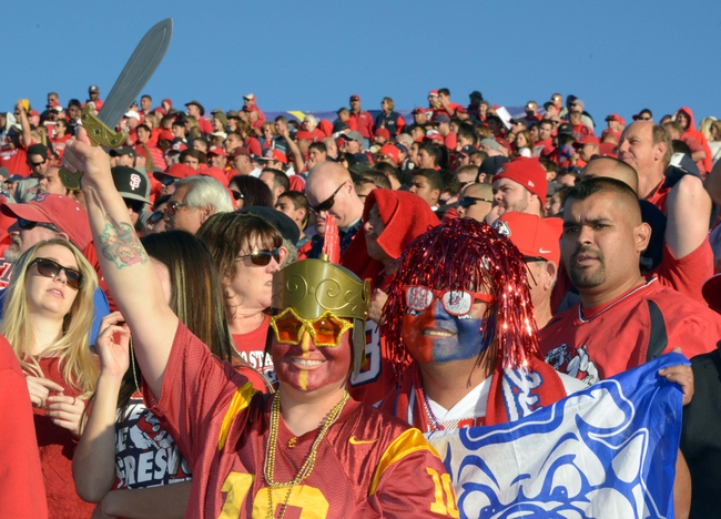 Dec 21, 2013; Las Vegas, NV, USA; Southern California Trojans and Fresno State Bulldogs fans pose at the Las Vegas Bowl at Sam Boyd Stadium. USC defeated Fresno State 45-20. Mandatory Credit: Kirby Lee-USA TODAY Sports