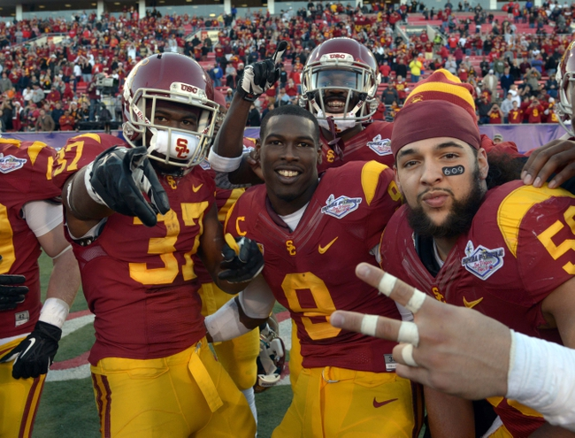 Dec 21, 2013; Las Vegas, NV, USA; Southern California Trojans players Javorious Allen (37), Marqise Lee (9) and Anthony Sarao (56) celebrate after the Las Vegas Bowl against the Fresno State Bulldogs at Sam Boyd Stadium. USC defeated Fresno State 45-20. Mandatory Credit: Kirby Lee-USA TODAY Sports