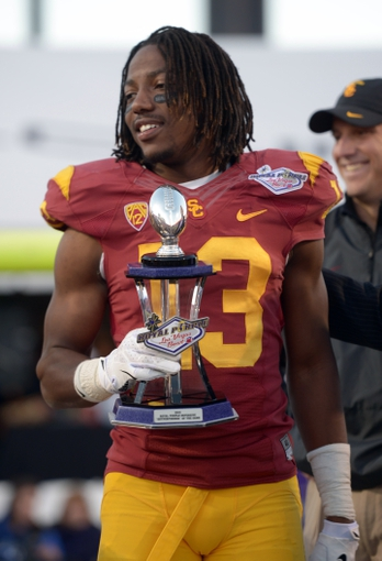 Dec 21, 2013; Las Vegas, NV, USA; Southern California Trojans cornerback Kevon Seymour (13) poses with the defensive out-performer award at the Las Vegas Bowl against the Fresno State Bulldogs at Sam Boyd Stadium. USC defeated Fresno State 45-20. Mandatory Credit: Kirby Lee-USA TODAY Sports