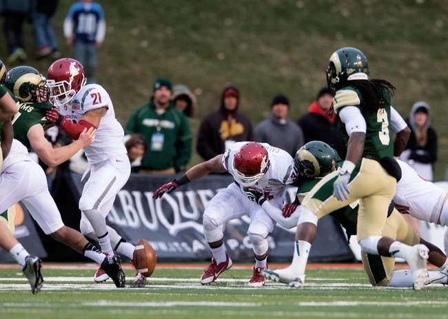 Dec 21, 2013; Albuquerque, NM, USA; Washington State Cougars running back Teondray Caldwell (34) fumbles the ball in the fourth quarter against the Colorado State Rams during the Gildan New Mexico Bowl at University Stadium. The Rams defeated the Cougars 48-45. Mandatory Credit: Mark J. Rebilas-USA TODAY Sports