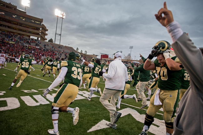 Dec 21, 2013; Albuquerque, NM, USA; Colorado State Rams run on the field to celebrate after defeating the Washington State Cougars during the Gildan New Mexico Bowl at University Stadium. The Rams defeated the Cougars 48-45. Mandatory Credit: Mark J. Rebilas-USA TODAY Sports