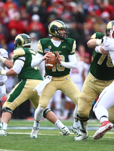 Dec 21, 2013; Albuquerque, NM, USA; Colorado State Rams quarterback Garrett Grayson (18) throws a pass in the second half against the Washington State Cougars during the Gildan New Mexico Bowl at University Stadium. The Rams defeated the Cougars 48-45. Mandatory Credit: Mark J. Rebilas-USA TODAY Sports
