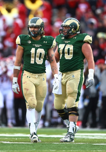 Dec 21, 2013; Albuquerque, NM, USA; Colorado State Rams tight end Crockett Gillmore (10) and offensive lineman Weston Richburg (70) in the second half against the Washington State Cougars during the Gildan New Mexico Bowl at University Stadium. The Rams defeated the Cougars 48-45. Mandatory Credit: Mark J. Rebilas-USA TODAY Sports