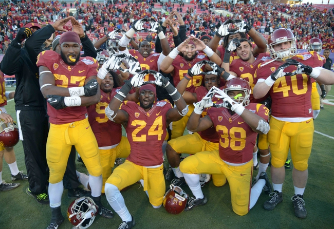 Dec 21, 2013; Las Vegas, NV, USA; Southern California Trojans players celebrate after the Las Vegas Bowl against the Fresno State Bulldogs at Sam Boyd Stadium. USC defeated Fresno State 45-20. Mandatory Credit: Kirby Lee-USA TODAY Sports