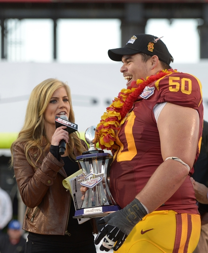 Dec 21, 2013; Las Vegas, NV, USA; Southern California Trojans center Abe Markowitz (50) is interviewed by ESPN reporter Samantha Ponder after being named the offensive out performer of the Las Vegas Bowl against the Fresno State Bulldogs at Sam Boyd Stadium. USC defeated Fresno State 45-20. Mandatory Credit: Kirby Lee-USA TODAY Sports