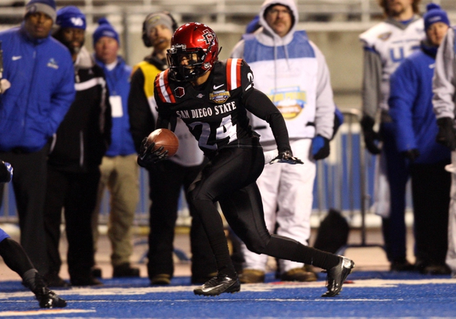 Dec 21, 2013; Boise, ID, USA; San Diego State Aztecs wide receiver Colin Lockett (24) runs for a first down during the second half of the Idaho Potato Bowl against the Buffalo Bulls at Bronco Stadium. San Diego defeated Buffalo 49-24. Mandatory Credit: Brian Losness-USA TODAY Sports