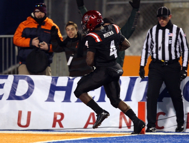 Dec 21, 2013; Boise, ID, USA; San Diego State Aztecs running back Adam Muema (4) scores a touchdown during the second half of the Idaho Potato Bowl against the Buffalo Bulls at Bronco Stadium. San Diego defeated Buffalo 49-24. Mandatory Credit: Brian Losness-USA TODAY Sports