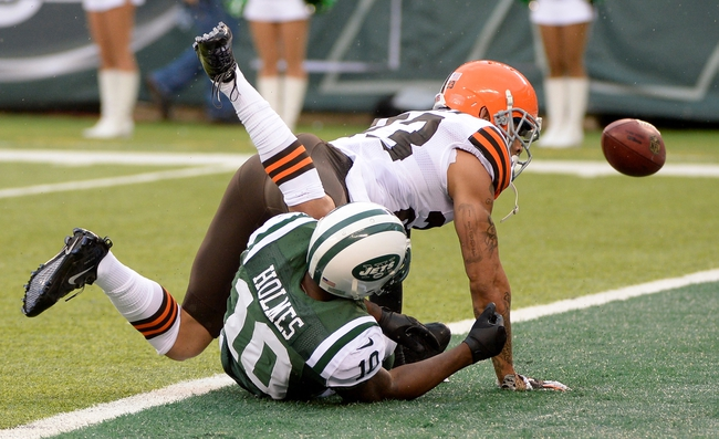 Dec 22, 2013; East Rutherford, NJ, USA; Cleveland Browns cornerback Joe Haden (23) breaks up a pass intended for New York Jets wide receiver Santonio Holmes (10) in the first half during the game at MetLife Stadium. Mandatory Credit: Robert Deutsch-USA TODAY Sports