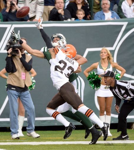 Dec 22, 2013; East Rutherford, NJ, USA; New York Jets wide receiver David Nelson (rear) is unable to catch a pass while defended by Cleveland Browns cornerback Joe Haden (23) during the game at MetLife Stadium. Mandatory Credit: Robert Deutsch-USA TODAY Sports