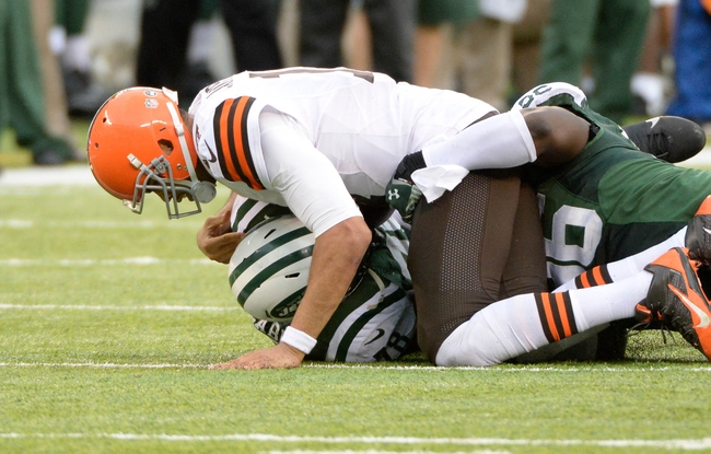 Dec 22, 2013; East Rutherford, NJ, USA; New York Jets defensive tackle Leger Douzable (78) and defensive end Muhammad Wilkerson (96) combine to sack Cleveland Browns quarterback Jason Campbell (17) during the game at MetLife Stadium. Mandatory Credit: Robert Deutsch-USA TODAY Sports