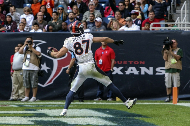 Dec 22, 2013; Houston, TX, USA; Denver Broncos wide receiver Eric Decker (87) scores a touchdown during the fourth quarter against the Houston Texans at Reliant Stadium. Mandatory Credit: Troy Taormina-USA TODAY Sports