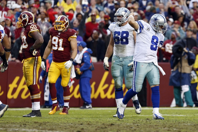 Dec 22, 2013; Landover, MD, USA; Dallas Cowboys quarterback Tony Romo (9) celebrates after throwing the game winning touchdown against the Washington Redskins in the final minute of the fourth quarter at FedEx Field. The Cowboys won 24-23. Mandatory Credit: Geoff Burke-USA TODAY Sports