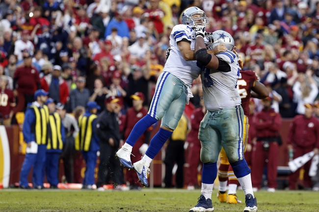 Dec 22, 2013; Landover, MD, USA; Dallas Cowboys quarterback Tony Romo (9) celebrates with Cowboys guard Mackenzy Bernadeau (73) after throwing the game winning touchdown against the Washington Redskins in the final minute of the fourth quarter at FedEx Field. The Cowboys won 24-23. Mandatory Credit: Geoff Burke-USA TODAY Sports