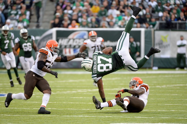 Dec 22, 2013; East Rutherford, NJ, USA; New York Jets tight end Jeff Cumberland (87) is flipped over by Cleveland Browns free safety Tashaun Gipson (39) in the second half during the game at MetLife Stadium. Mandatory Credit: Robert Deutsch-USA TODAY Sports