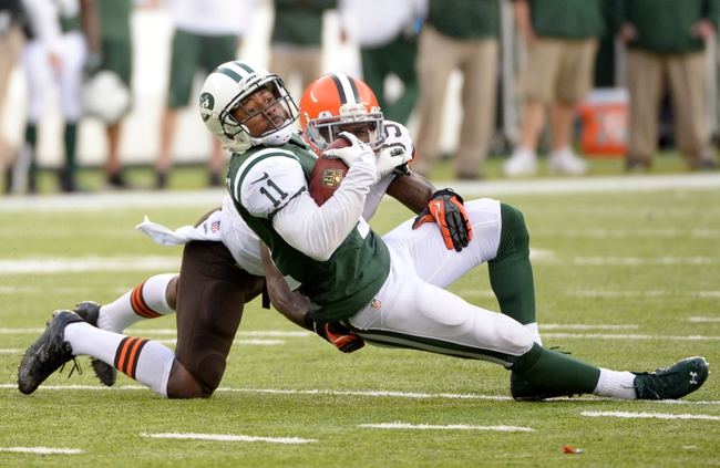 Dec 22, 2013; East Rutherford, NJ, USA; New York Jets wide receiver Jeremy Kerley (11) is tackled by Cleveland Browns free safety Tashaun Gipson (39) during the game at MetLife Stadium. Mandatory Credit: Robert Deutsch-USA TODAY Sports