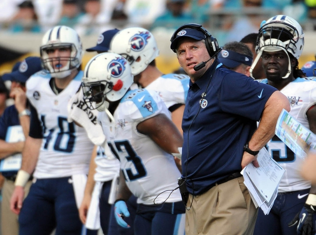 Dec 22, 2013; Jacksonville, FL, USA; Tennessee Titans head coach Mike Munchak during the game against the Jacksonville Jaguars at EverBank Field. Mandatory Credit: Melina Vastola-USA TODAY Sports