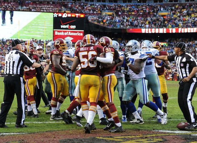 Dec 8, 2013; Landover, MD, USA; Washington Redskins and Dallas Cowboys players push each other during the second half at FedEx Field. Mandatory Credit: Brad Mills-USA TODAY Sports