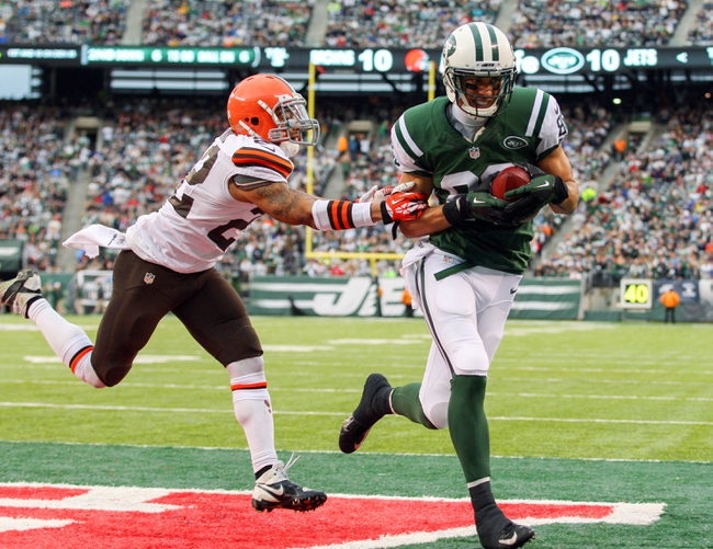 Dec 22, 2013; East Rutherford, NJ, USA; New York Jets wide receiver David Nelson (86) catches a touchdown pass while being defended by Cleveland Browns cornerback Buster Skrine (22) during the second half at MetLife Stadium.  The Jets defeated the Browns 24-13.  Mandatory Credit: Ed Mulholland-USA TODAY Sports