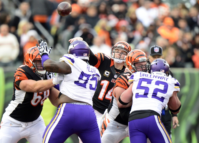 Dec 22, 2013; Cincinnati, OH, USA; Cincinnati Bengals quarterback Andy Dalton (14) passes the ball over the defense during the second half of the game against the Minnesota Vikings at Paul Brown Stadium. Cincinnati Bengals beat Minnesota Vikings 42-14.  Mandatory Credit: Marc Lebryk-USA TODAY Sports
