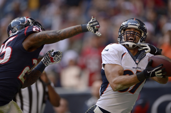 Dec 22, 2013; Houston, TX, USA; Denver Broncos wide receiver Eric Decker (87) catches a pass for a touchdown against the Houston Texans during the second half at Reliant Stadium. The Broncos won 37-13. Mandatory Credit: Thomas Campbell-USA TODAY Sports