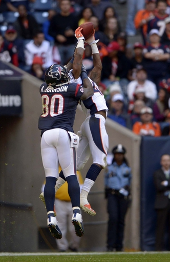 Dec 22, 2013; Houston, TX, USA; Denver Broncos cornerback Dominique Rodgers-Cromartie (45) intercepts a pass intended for Houston Texans wide receiver Andre Johnson (80) during the second half at Reliant Stadium. The Broncos won 37-13. Mandatory Credit: Thomas Campbell-USA TODAY Sports