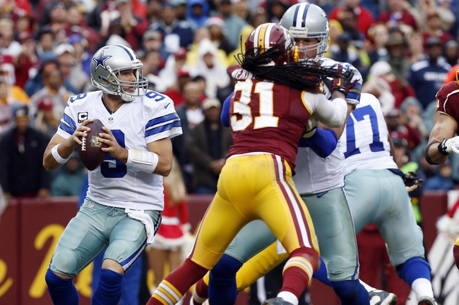 Dec 22, 2013; Landover, MD, USA; Dallas Cowboys quarterback Tony Romo (9) prepares to throw the ball as Washington Redskins strong safety Brandon Meriweather (31) chases in the third quarter at FedEx Field. The Cowboys won 24-23. Mandatory Credit: Geoff Burke-USA TODAY Sports