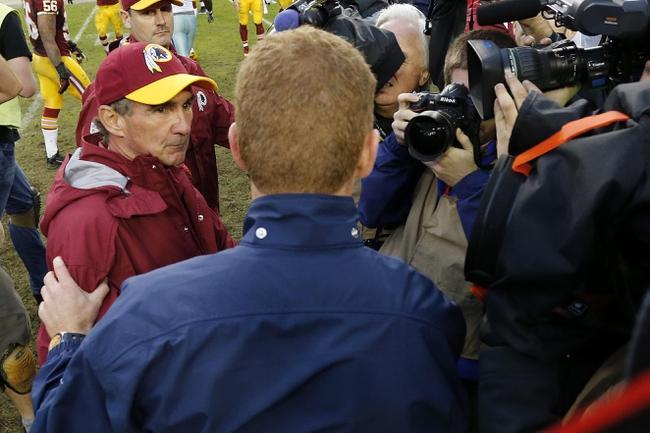 Dec 22, 2013; Landover, MD, USA; Washington Redskins head coach Mike Shanahan (L) shakes hands with Dallas Cowboys head coach Jason Garrett (R) after their game at FedEx Field. The Cowboys won 24-23. Mandatory Credit: Geoff Burke-USA TODAY Sports