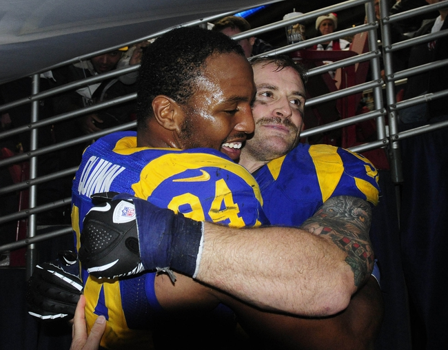 Dec 22, 2013; St. Louis, MO, USA; St. Louis Rams defensive end Robert Quinn (94) celebrates with defensive end Chris Long (91) after getting his franchise leading eighteenth sack of the season against the Tampa Bay Buccaneers during the second half at the Edward Jones Dome. The Rams defeated the Buccaneers 23-13. Mandatory Credit: Jeff Curry-USA TODAY Sports
