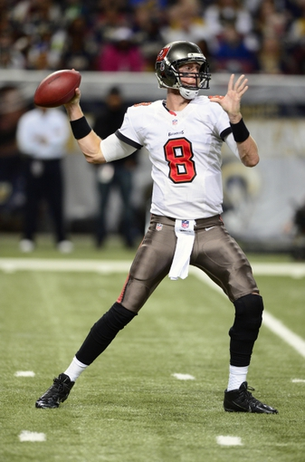 Dec 22, 2013; St. Louis, MO, USA; Tampa Bay Buccaneers quarterback Mike Glennon (8) throws against the St. Louis Rams during the second half at the Edward Jones Dome. The Rams defeated the Buccaneers 23-13. Mandatory Credit: Jeff Curry-USA TODAY Sports
