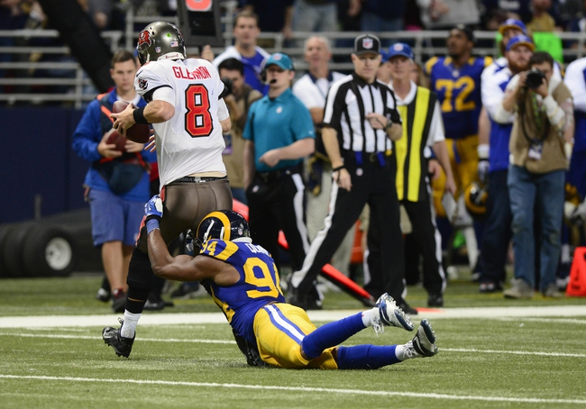 Dec 22, 2013; St. Louis, MO, USA; St. Louis Rams defensive end Robert Quinn (94) sacks Tampa Bay Buccaneers quarterback Mike Glennon (8) for his franchise leading eighteenth sack of the season during the second half at the Edward Jones Dome. The Rams defeated the Buccaneers 23-13. Mandatory Credit: Jeff Curry-USA TODAY Sports