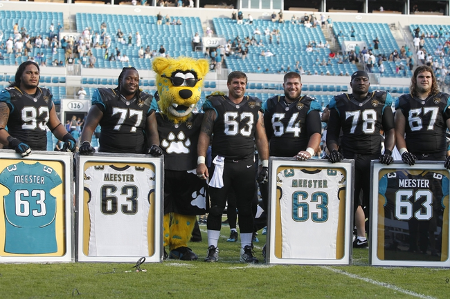 Dec 22, 2013; Jacksonville, FL, USA; Jacksonville Jaguars center Brad Meester (63) smiles with teamamets after he was honored after the game as he is retiring after he played 14 seasons at EverBank Field. Tennessee Titans defeated the Jacksonville Jaguars 20-16.  Mandatory Credit: Kim Klement-USA TODAY Sports