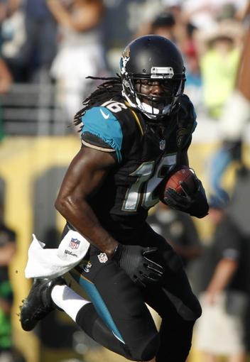 Dec 22, 2013; Jacksonville, FL, USA; Jacksonville Jaguars running back Denard Robinson (16) runs with the ball against the Tennessee Titans during the second half at EverBank Field. Tennessee Titans defeated the Jacksonville Jaguars 20-16.  Mandatory Credit: Kim Klement-USA TODAY Sports