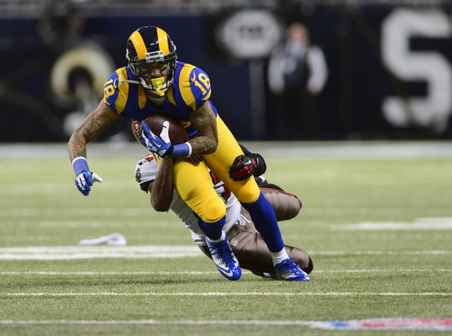 Dec 22, 2013; St. Louis, MO, USA; St. Louis Rams wide receiver Austin Pettis (18) reaches for a first down against the Tampa Bay Buccaneers during the second half at the Edward Jones Dome. The Rams defeated the Buccaneers 23-13. Mandatory Credit: Jeff Curry-USA TODAY Sports