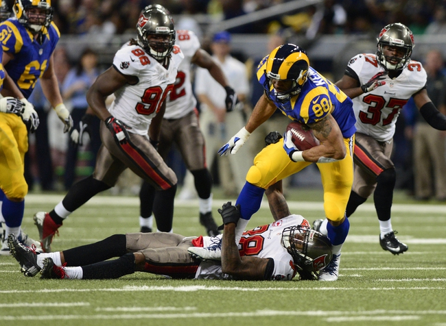 Dec 22, 2013; St. Louis, MO, USA; St. Louis Rams tight end Lance Kendricks (88) is tackled by Tampa Bay Buccaneers free safety Dashon Goldson (38) during the second half at the Edward Jones Dome. The Rams defeated the Buccaneers 23-13. Mandatory Credit: Jeff Curry-USA TODAY Sports