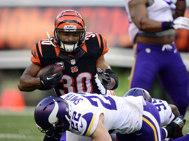 Dec 22, 2013; Cincinnati, OH, USA; Cincinnati Bengals running back Cedric Peerman (30) is tackled by Minnesota Vikings free safety Harrison Smith (22) during the second half of the game at Paul Brown Stadium. Cincinnati Bengals beat Minnesota Vikings 42-14.  Mandatory Credit: Marc Lebryk-USA TODAY Sports