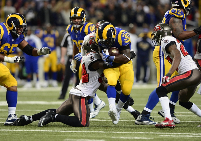 Dec 22, 2013; St. Louis, MO, USA; St. Louis Rams running back Zac Stacy (30) runs against the Tampa Bay Buccaneers during the second half at the Edward Jones Dome. The Rams defeated the Buccaneers 23-13. Mandatory Credit: Jeff Curry-USA TODAY Sports