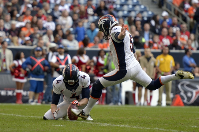 Dec 22, 2013; Houston, TX, USA; Denver Broncos kicker Matt Prater (5) kicks an extra point against the Houston Texans during the second half at Reliant Stadium. The Broncos won 37-13. Mandatory Credit: Thomas Campbell-USA TODAY Sports