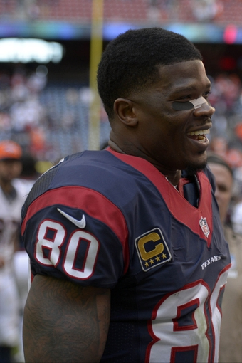 Dec 22, 2013; Houston, TX, USA; Houston Texans wide receiver Andre Johnson (80) smiles after the game against the Denver Broncos at Reliant Stadium. The Broncos won 37-13. Mandatory Credit: Thomas Campbell-USA TODAY Sports