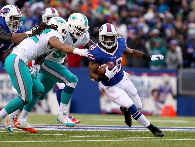Dec 22, 2013; Orchard Park, NY, USA; Buffalo Bills running back C.J. Spiller (28) runs the ball during the second half against the Miami Dolphins at Ralph Wilson Stadium. Buffalo beats Miami 19-0.  Mandatory Credit: Timothy T. Ludwig-USA TODAY Sports