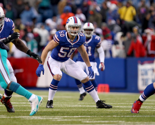Dec 22, 2013; Orchard Park, NY, USA; Buffalo Bills middle linebacker Kiko Alonso (50) looks to make a tackle during the second half against the Miami Dolphins at Ralph Wilson Stadium. Buffalo beats Miami 19-0.  Mandatory Credit: Timothy T. Ludwig-USA TODAY Sports