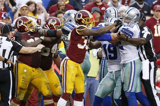 Dec 22, 2013; Landover, MD, USA; Washington Redskins and Dallas Cowboys players fight in the final minute of the fourth quarter at FedEx Field. The Cowboys won 24-23. Mandatory Credit: Geoff Burke-USA TODAY Sports