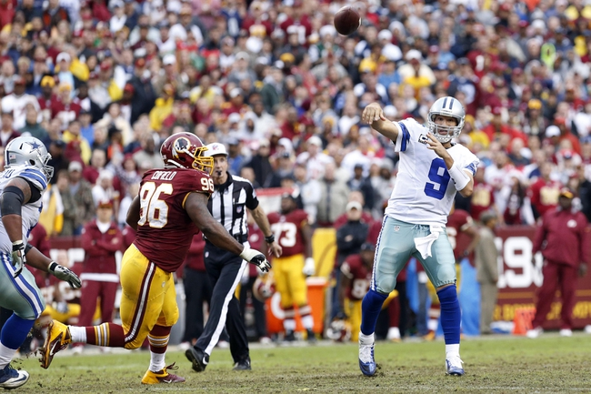 Dec 22, 2013; Landover, MD, USA; Dallas Cowboys quarterback Tony Romo (9) throws the ball as Washington Redskins nose tackle Barry Cofield (96) chases in the fourth quarter at FedEx Field. The Cowboys won 24-23. Mandatory Credit: Geoff Burke-USA TODAY Sports