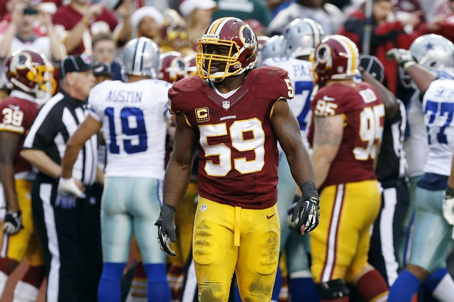 Dec 22, 2013; Landover, MD, USA; Washington Redskins inside linebacker London Fletcher (59) stands on the field after the Dallas Cowboys scored the game winning touchdown in the final minute of the fourth quarter at FedEx Field. The Cowboys won 24-23. Mandatory Credit: Geoff Burke-USA TODAY Sports