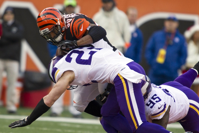 Dec 22, 2013; Cincinnati, OH, USA;  Cincinnati Bengals running back Cedric Peerman (30) is tackled by Minnesota Vikings free safety Harrison Smith (22) and defensive tackle Sharrif Floyd (95) in the fourth quarter of the game at Paul Brown Stadium. Cincinnati Bengals beat the Minnesota Vikings by the score of 42-14. Mandatory Credit: Trevor Ruszkowksi-USA TODAY Sports