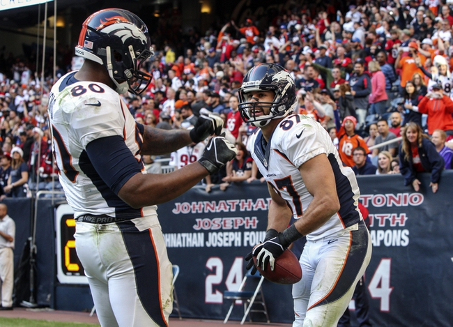 Dec 22, 2013; Houston, TX, USA; Denver Broncos tight end Julius Thomas (80) and wide receiver Eric Decker (87) celebrate after Thomas scores a touchdown during the fourth quarter against the Houston Texans t Reliant Stadium. The Broncos defeated the Texans 37-13. Mandatory Credit: Troy Taormina-USA TODAY Sports